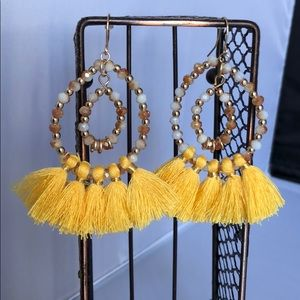 Round with yellow tassels earrings